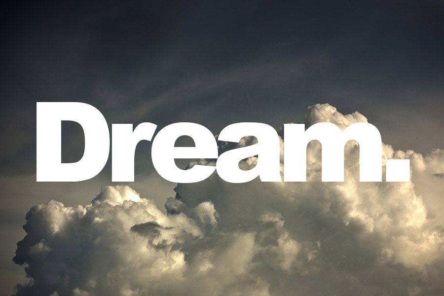 Fluffy white clouds with 'Dream' quote